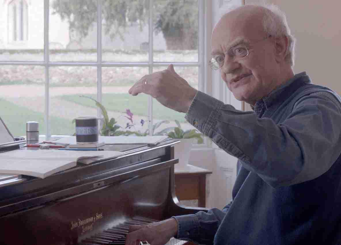 John Rutter at a piano